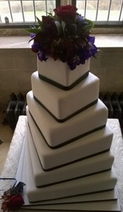 five tier green ribbon wedding cake