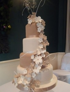 four tier fawn white garland wedding cake
