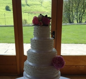 four tier frilly wedding cake