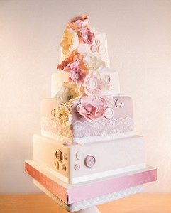 four tier pink white wedding cake