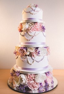 four tier purple white rose wedding cake
