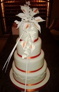 four tier scarlett ribbon wedding cake