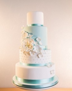four tier white blue wedding cake