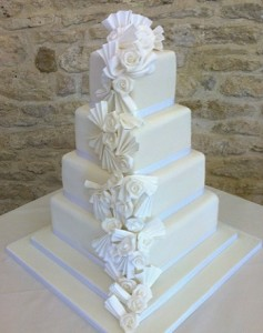 four tier white ribbon wedding cake