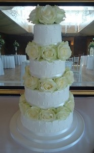 four tier white rose wedding cake