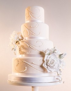 four tier white scroll wedding cake