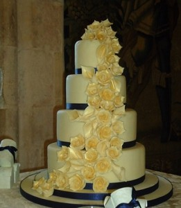 four tier yellow rose wedding cake