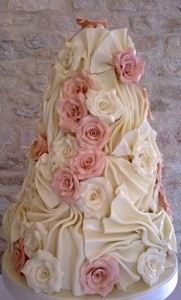 pink white rose icing wedding cake
