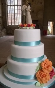 three tier blue ribbon wedding cake