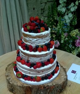 three tier fruit decorated wedding cake
