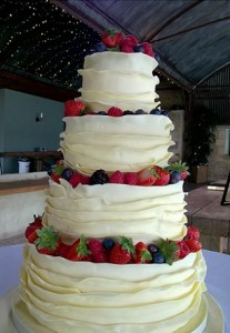 three tier fruit iced wedding cake