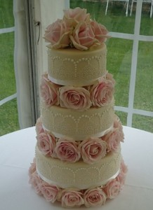 three tier pink rose wedding cake