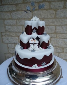 three tier purple snowmen cake