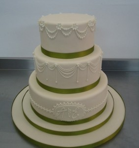 three tier white green wedding cake