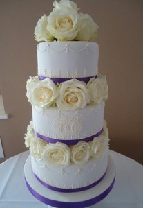three tier white rose iced wedding cake