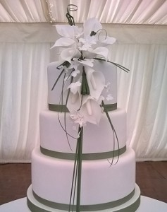 three tier white icing wedding cake