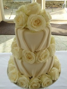 white iced rose wedding cake