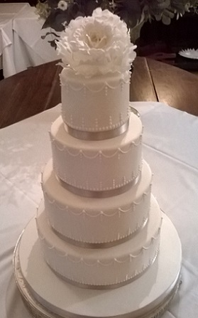 white wedding cake with silver ribbon four tier white silver ribbon wedding cake contemporary 27422